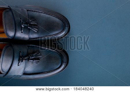 Blue Loafer Shoes On Blue Background. One Pair. Top View. Copy Space.