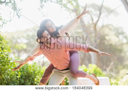 Man giving piggyback ride to woman in the restaurant