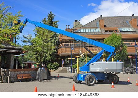Cherry picker working in Whistler, British Columbia