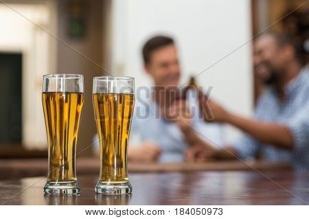 Beer glasses kept on wooden table in the restaurant