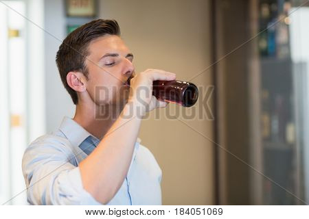 Handsome man drinking beer in the restaurant