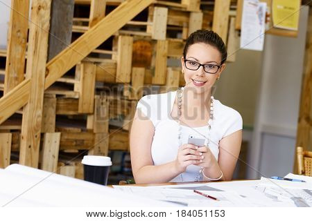 Young woman architect in office