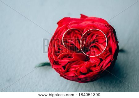 red peony is on the table it wedding rings