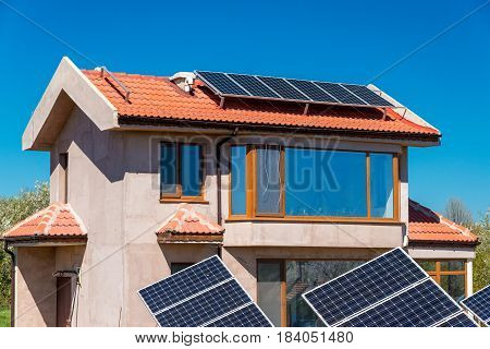 Solar Panel On A Red Roof - Alternative Electricity Source