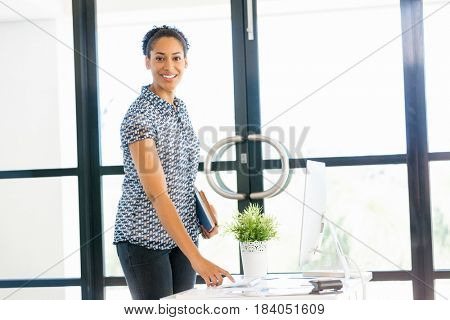 Portrait of smiling afro-american office worker standing in offfice