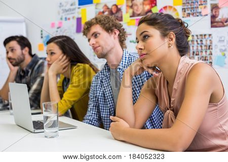 Tired executives listening presentation in conference room at office