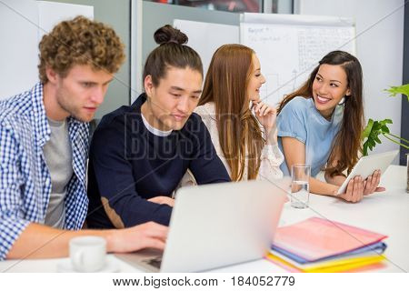 Smiling executives working in office