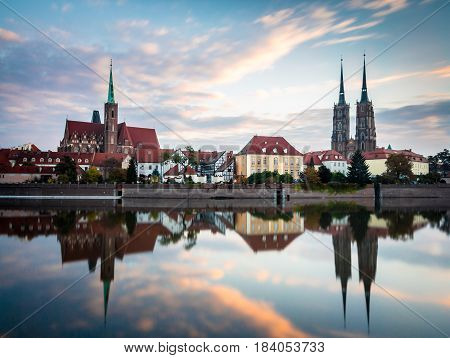 Wroclaw Poland 22nd october 2016. Panoramic view of Ostrow Tumski in Wroclaw at sunrise with beautiful clouds in the sky. Ostrow Tumski (Cathedral Island) and the church of the holy cross and st. bartholomew.