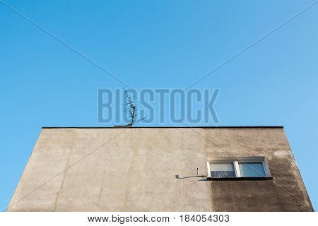 Looking up towards the grey facade of socialist housing in eastern europe. Wroclaw Poland.