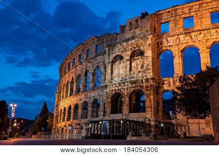 Pula amphitheatre during the morning blue hour from the outside