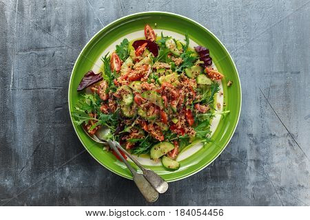 Quinoa tabbouleh salad with tomatoes cucumber green onion. Concept healthy food.