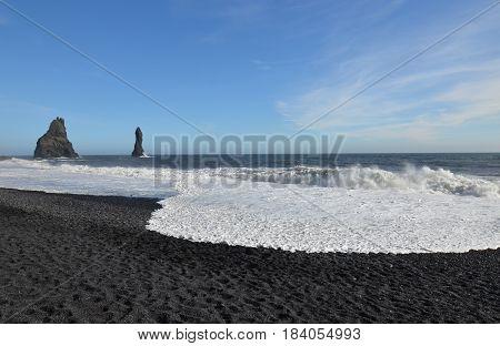 Reynisdrangar sea stacks on Reynisfjara beach in Vik Iceland.