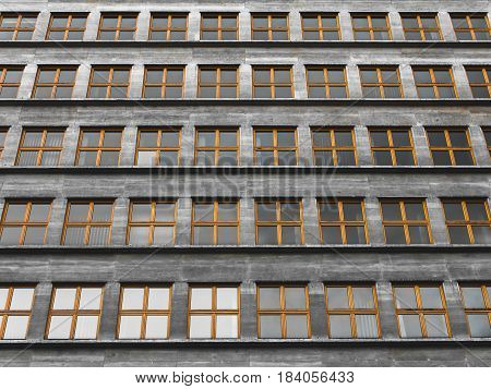 Endless repeated identical windows in a communist style building.