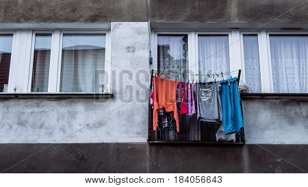Washed clothes hung out to dry outside the window of a communist style apartment block in Wroclaw Poland.