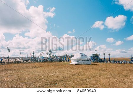 A Yurt In Mongolia Grassland With Blue Sky,horizontal