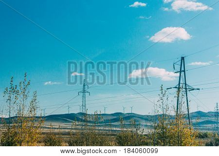 Blue Sky, Cloud,graddland,forest And Tree And Electric Power Transmission Pylon On Inner Mongolia Gr