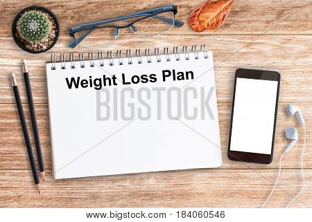 Flat lay Weight Loss Plan healthy eating dieting slimming and weigh loss concept with smart phone and glasses on office desk. top view with copy space