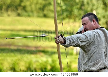 TERVETE LATVIA - AUGUST 13 2011: Historical Zemgalu days. Unknown archer demonstrate his skill.