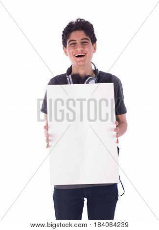 Portrait of smiley happy friendly young student holding an empty blank board teenager wearing gray t-shirt and jeans with a headphone and backbag isolated white background