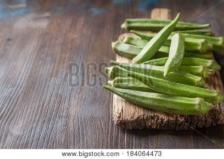 Lady Fingers Or Okra Over Wooden Table Background. Space For Tex