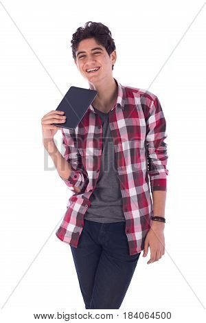 Portrait of smiley happy friendly young student standing confidently and holding tablet teenager wearing open red shirt and gray t-shirt and jeans isolated on white background