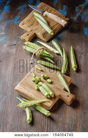 Lady Fingers Or Okra Over Wooden Table Background. Top View