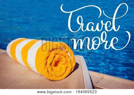 towel on a background of pool and text Travel more. Calligraphy lettering hand draw.
