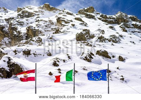 Italy Dolomites flags in the the Pordoi Pass