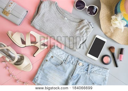 Fashion summer women clothes set with cosmetics and accessories Flat lay Top view