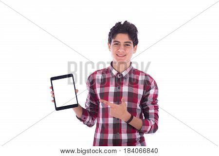 Smiliy frindly teenage boy holding the tablet and pointing to it teenager wearing red shirt isolated white background