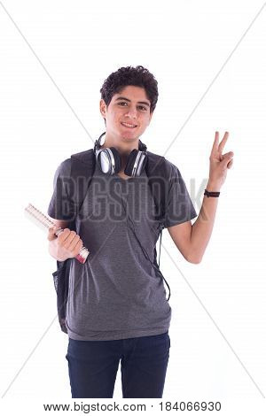 Portrait of smiley happy friendly young student standing confidently and holding a notebook teenager wearing gray t-shirt and jeans with a headphone and back-bag isolated on white background