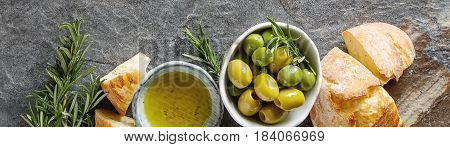 Olivier Oil With Fresh Herbs And Bread. Gray Background. Italian