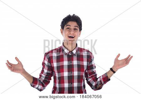 Portrait of smiley friendly teenage boy rising two hands and feeling happy teenager wearing red shirt isolated on white background