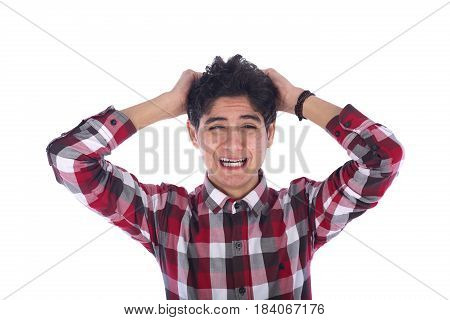Disappointed sad teenage boy crying and holding his hair teenager looking side and wearing red shirt isolated on white background