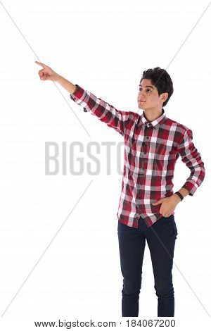 Portrait of smiley friendly teenage boy pointing up and looking sideteenager wearing red shirt and jeans isolated on white background