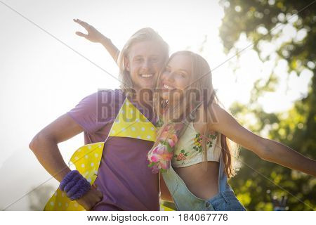 Portrait of romantic couple embracing each other in park on a sunny day