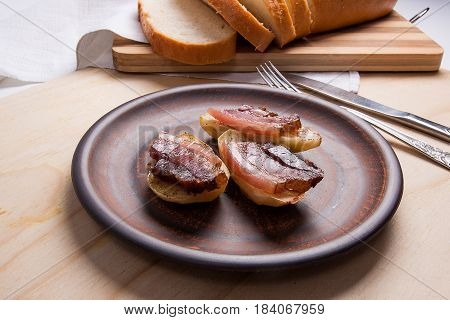 Baked Potatoes With Slices Of Bacon On Wooden Background. Slices Of White Bread On Cutting Board.
