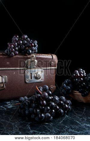 Cluster Of Blue Grapes On Dark Marble Background. Vintage Case On Back Background.