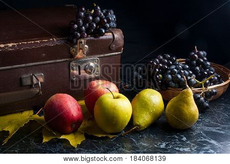Cluster Of Blue Grapes And Ripe Fruits On Dark Marble Background. Vintage Case On Back Background.
