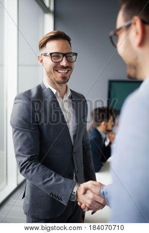 Business people shaking hands after agreeing to a business deal