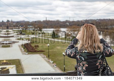 The Blonde Looks At The City