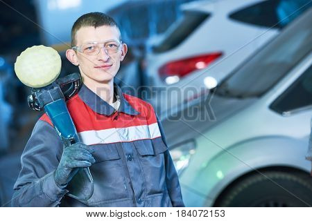 auto mechanic with buffing machine