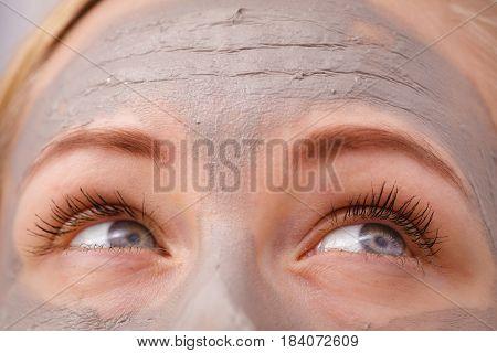 Closeup Of Woman Having Grey Mud Mask On Face