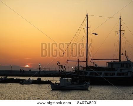 Beautiful sunset at the Old Port of Mykonos town, Mykonos island of Greece