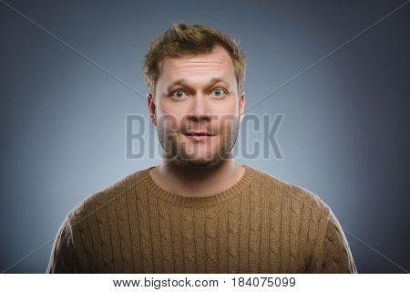 Close up face of discouraged man isolated grey background.