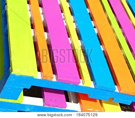 reclaimed pallet filled with bright awesome colors