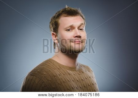 Arrogant bold self important stuck up man with napoleon complex, short man syndrome isolated on gray background