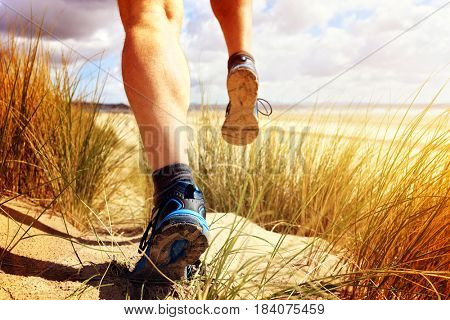 Fitness man running on the beach concept for exercising, fitness and healthy lifestyle