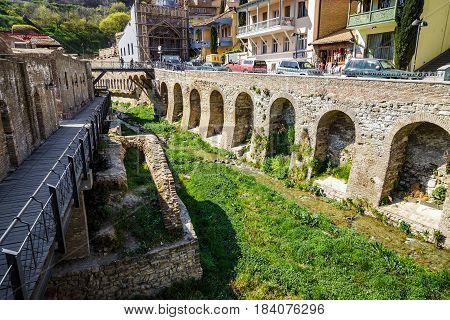 An old quarter with sulfur baths in Tbilisi a view of the shrunken canal. April 17 2015
