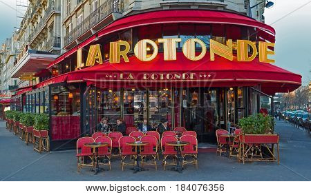 Paris France - December 22 2015: La Rotonde in the Montparnasse Quarter - one of the most legendary and the famous Parisian cafes. There were often Modigliani Picasso Chagall Kandinsky
